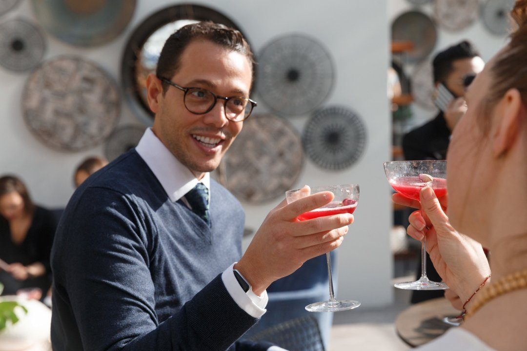 Guests sipping rose cocktails at Crate and Barrel Greenhouse