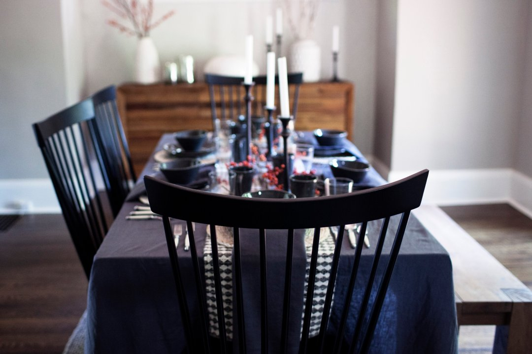View of table and chairs set for feast