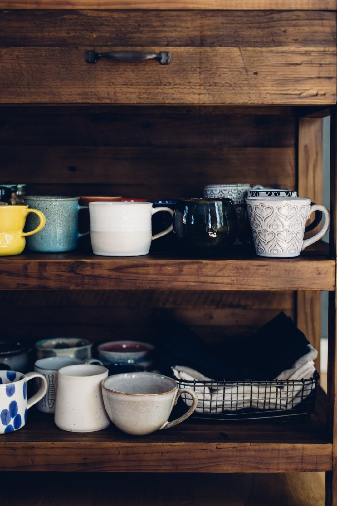 Shelves with all different artisan mugs