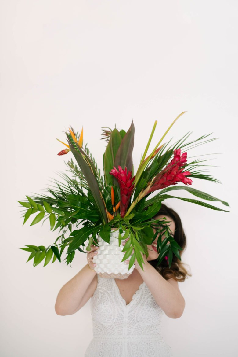 Woman holding vase of big bouquet