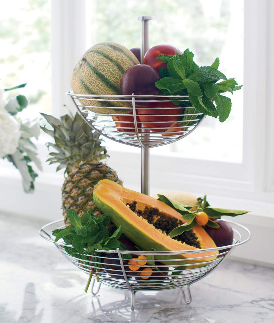 Two-tier fruit basket with tropical fruits
