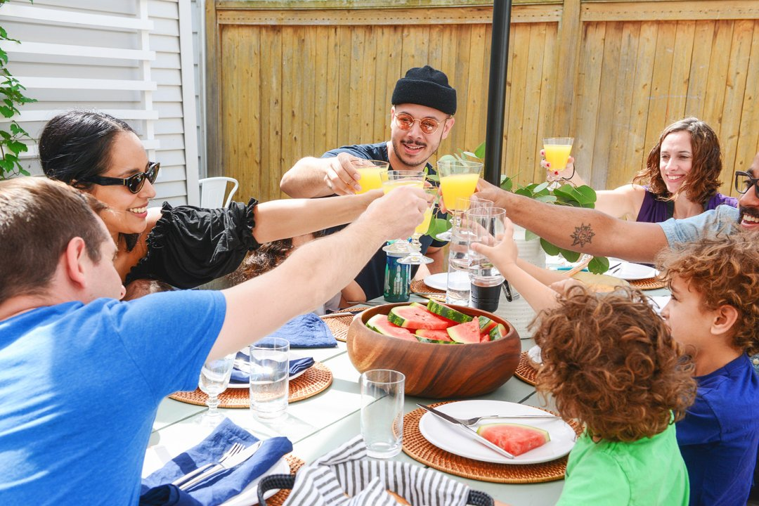 Friends toasting at table for brunch