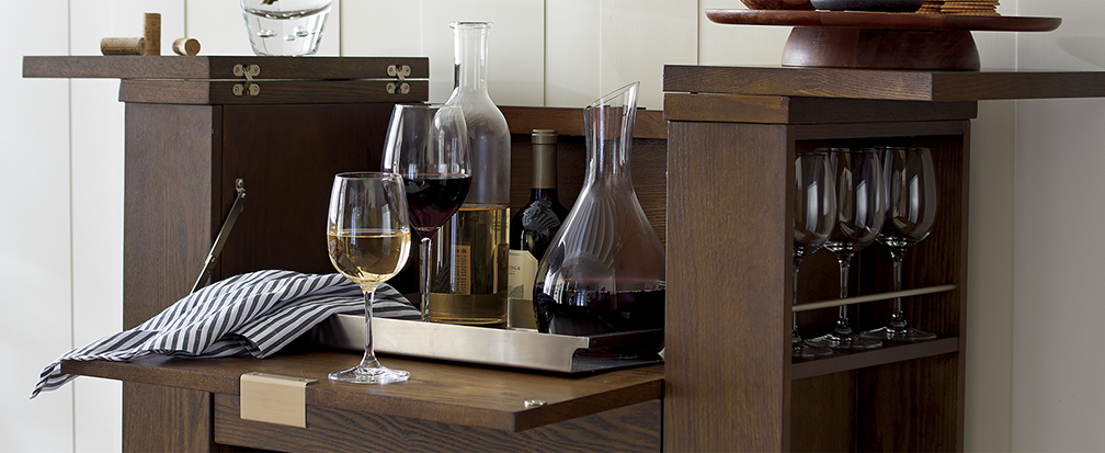 Stocked home bar with wine and decanter