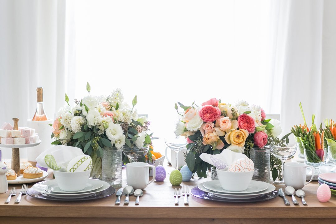Easter table decorations including pastel florals and dinnerware