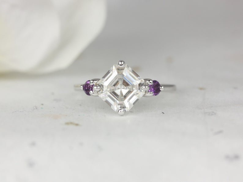 White gold band with Moissanite stone bookended with two dainty Amethyst stones