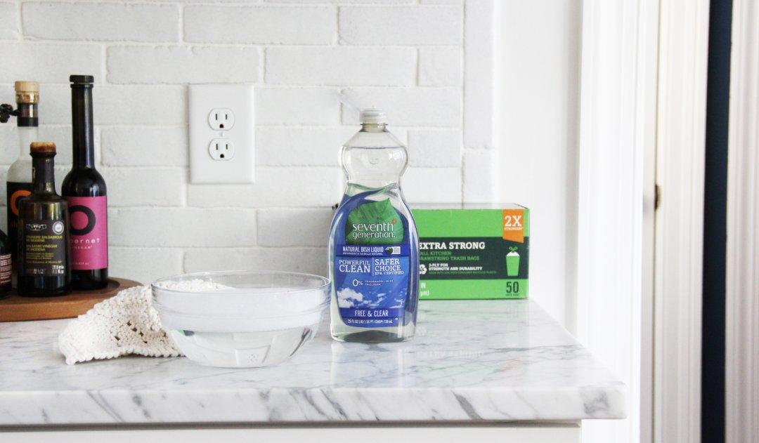 hand dish and trash bag carton on kitchen counter