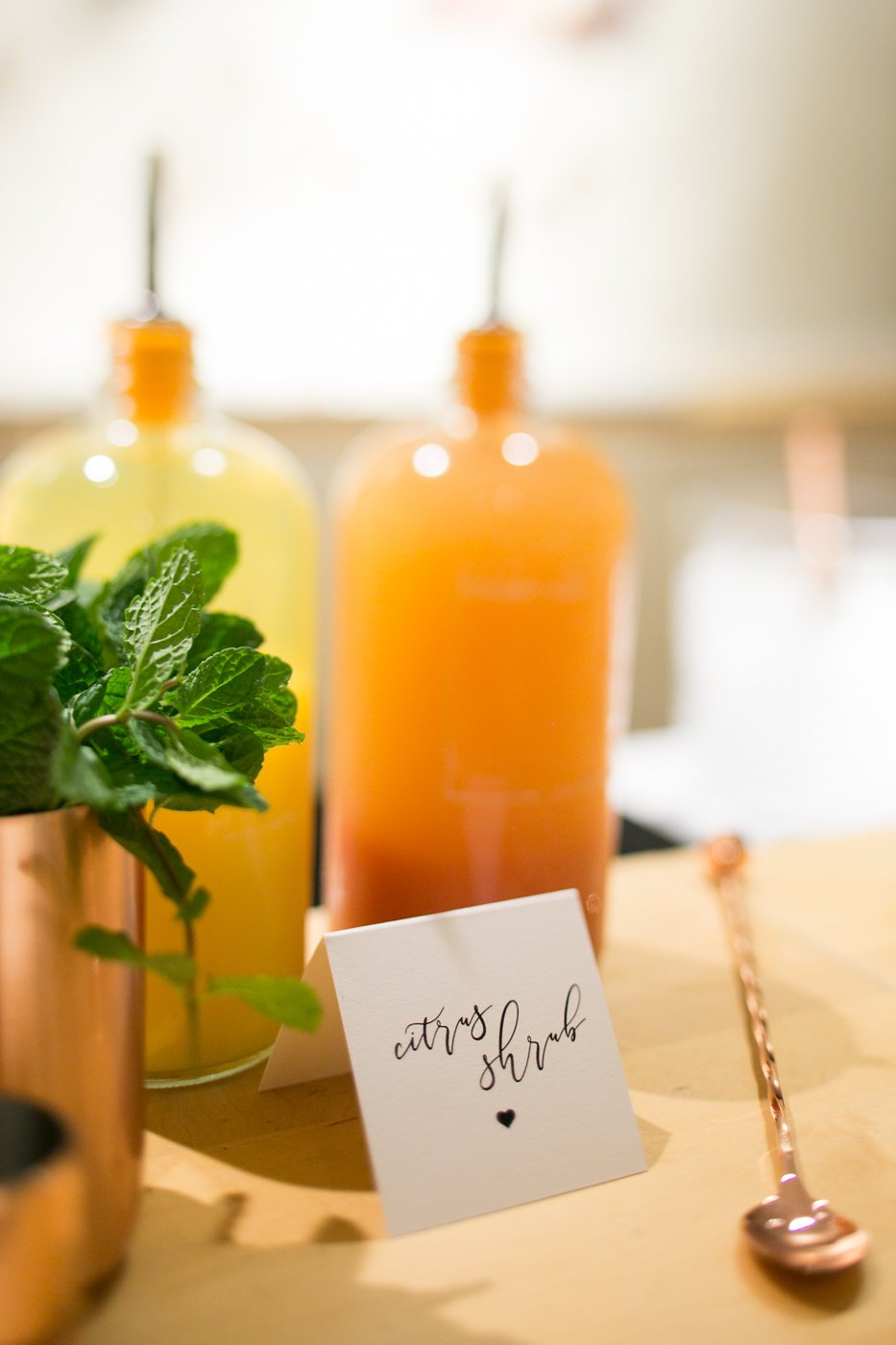 Citrus cocktail syrup in glass bottle