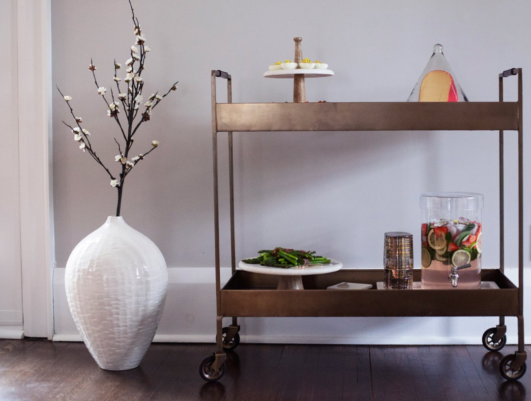 Easter recipes served on a brass barcart