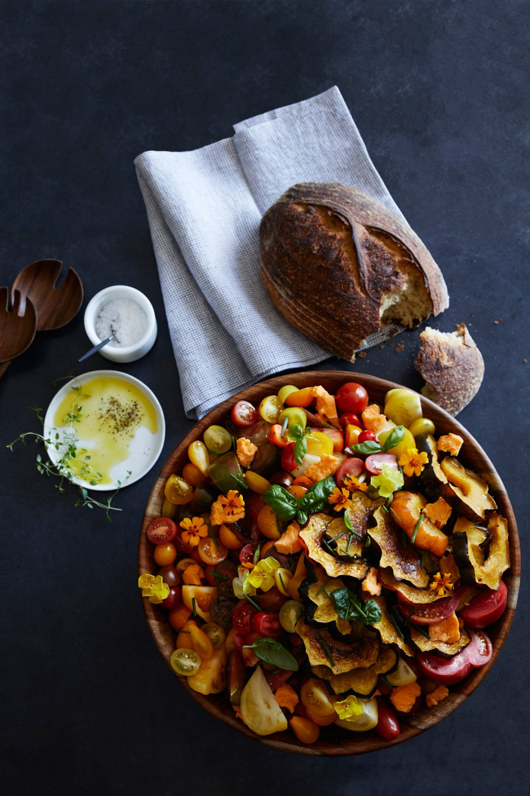 Late summer tomato and squash salad in wooden bowl
