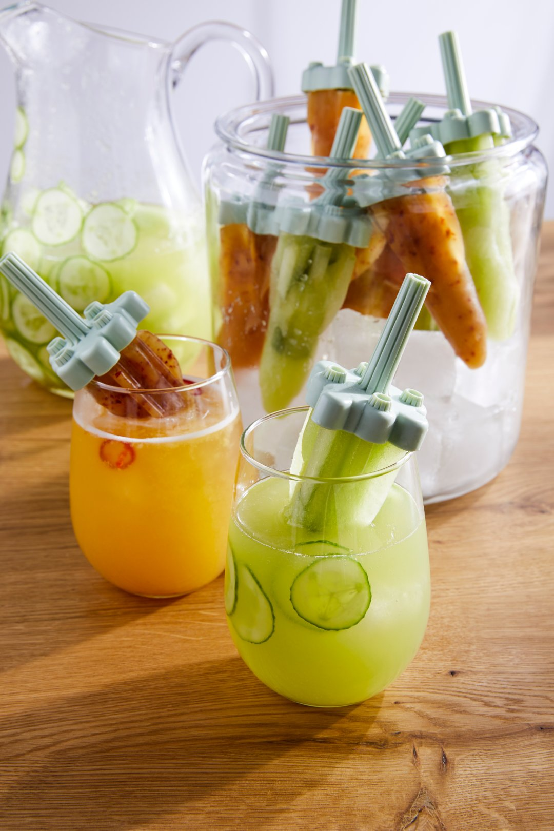 Honeydew and Cucumber margarita popsicles in stemless wine glasses