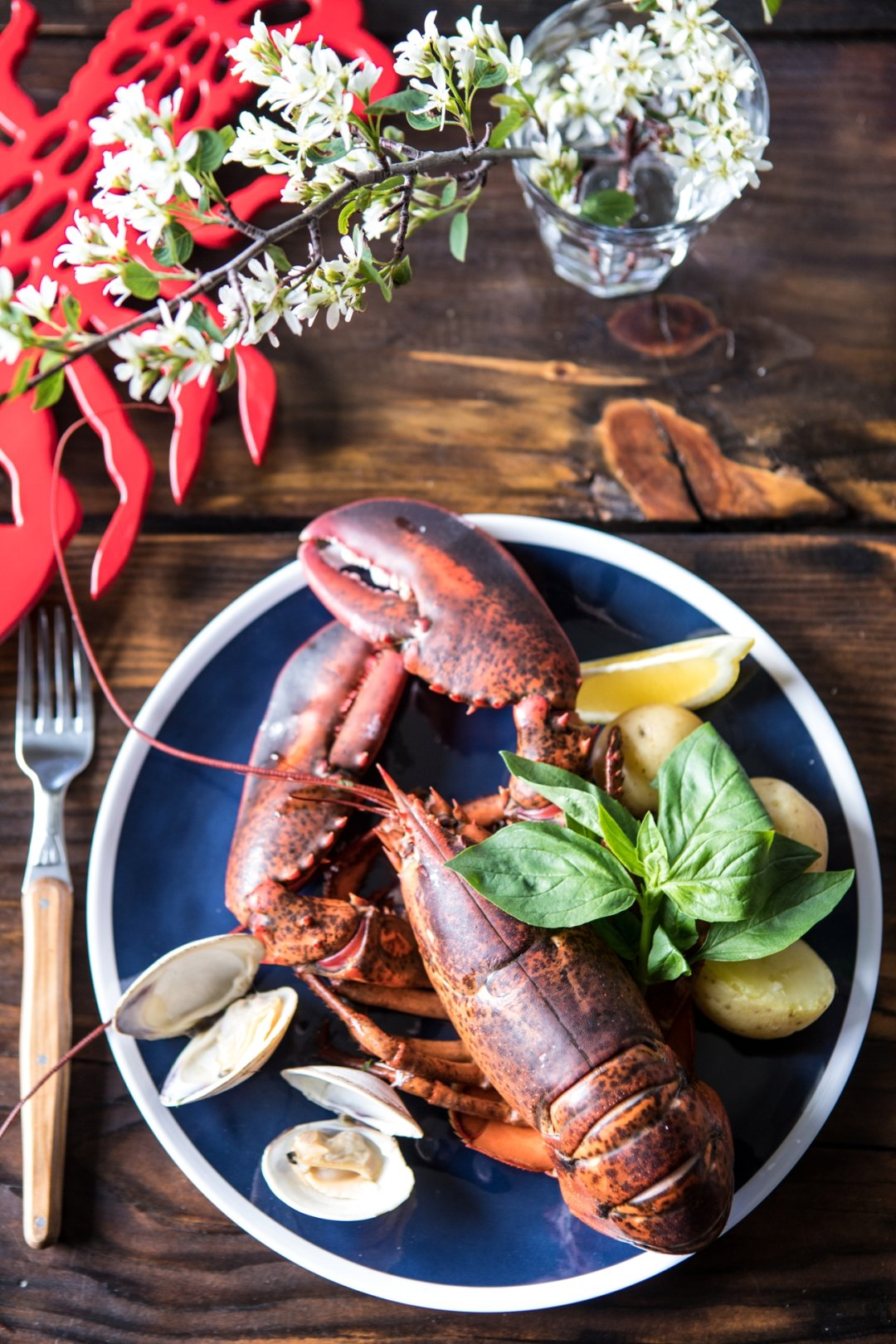 Cooked lobster on plate on table