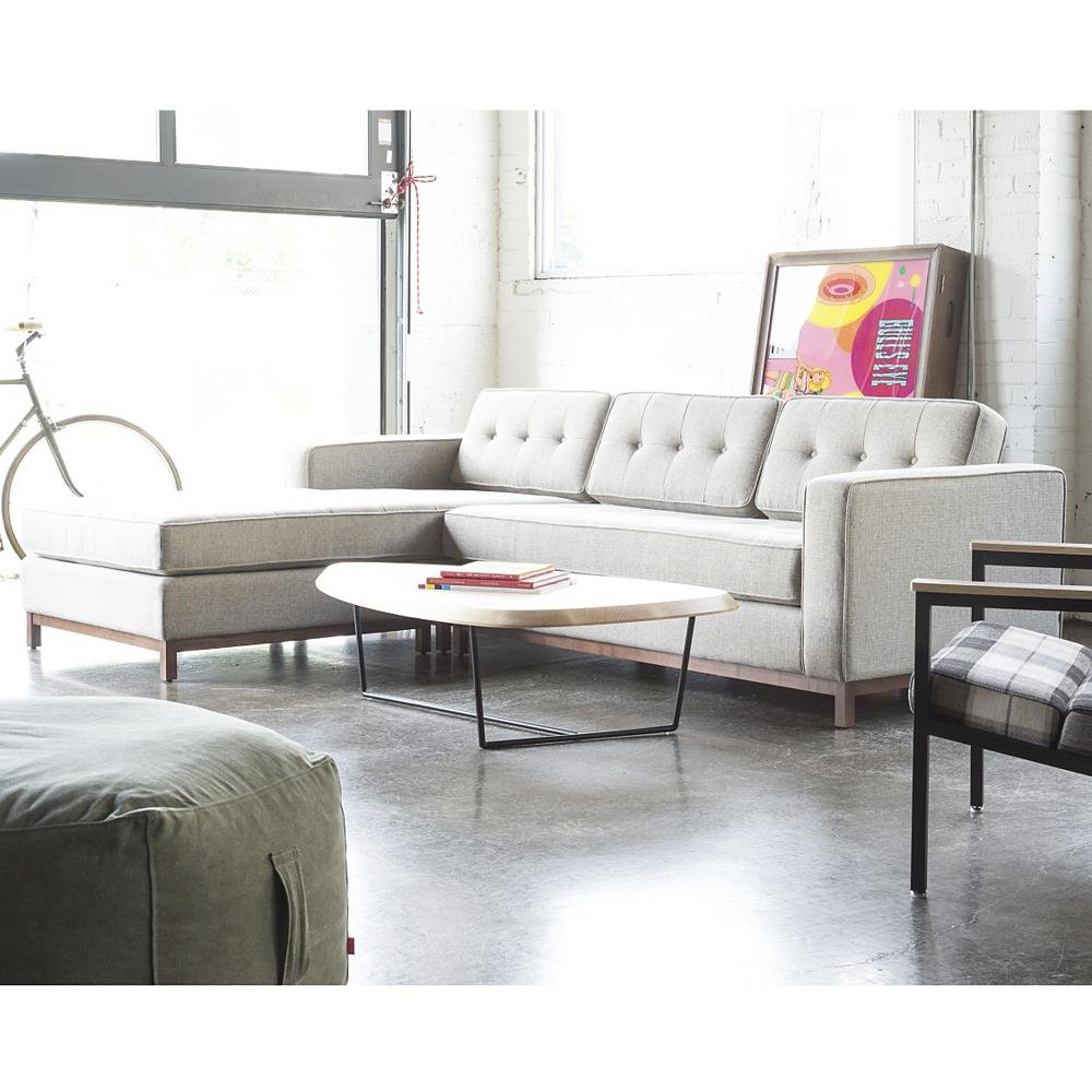 Curated image with jane bi sectional sofa by gus modern hull coffee table by