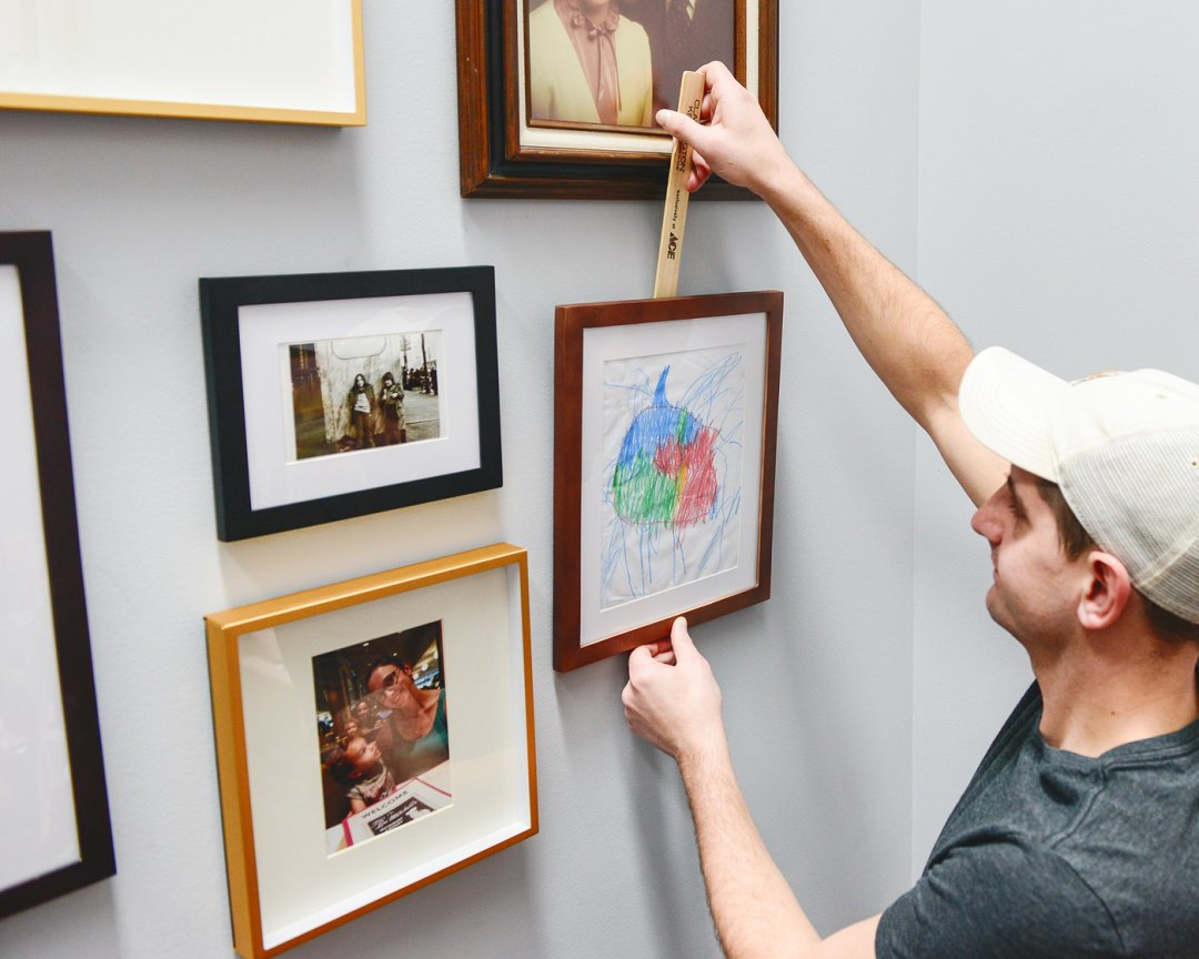 Hanging a photo on a photo wall