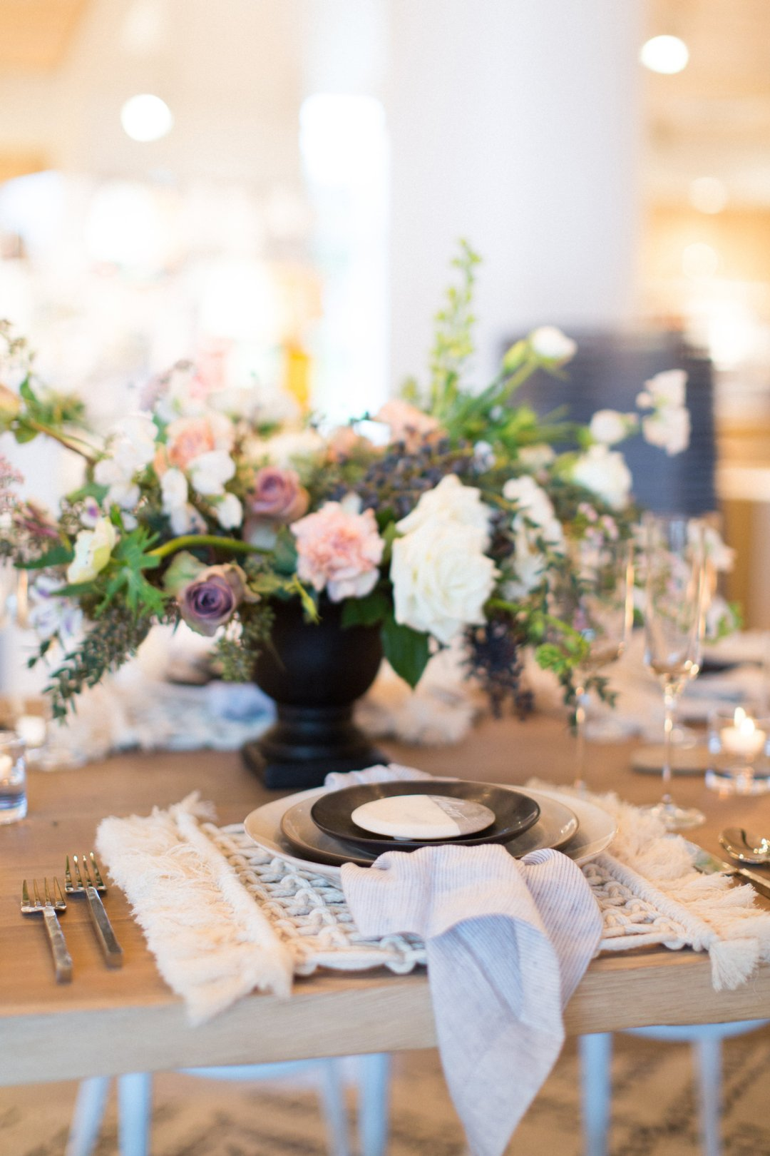 Boho wedding place setting with floral centerpiece