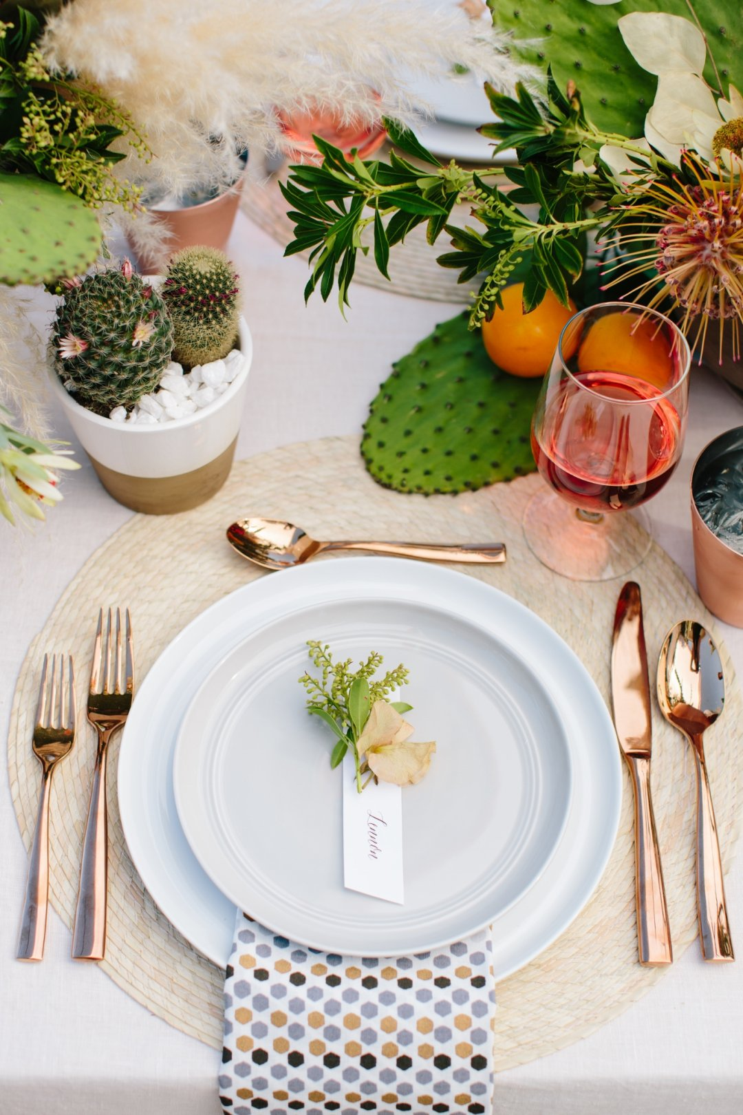 Close up of place setting with copper flatware