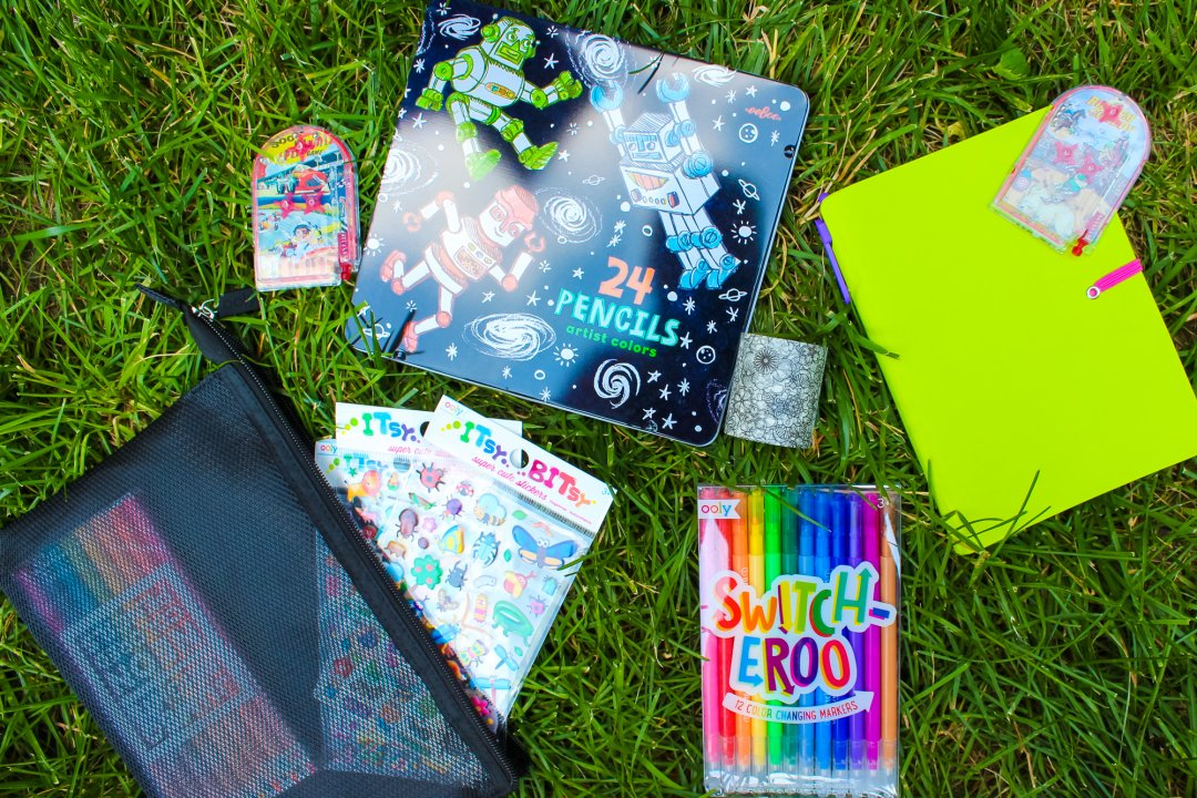 A kids craft kit with coloring books and crayons