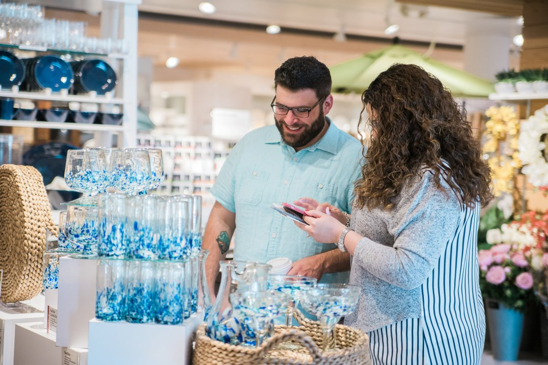 Couples scanning blue glasses for their wedding registry