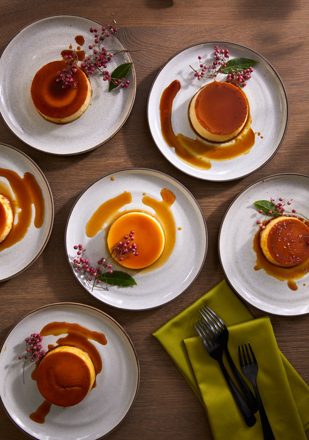 Flan served on 18th Street dinnerware with green napkins