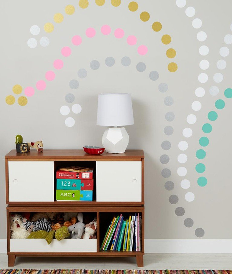 Polka dot wall decals make a stunning pattern on a child's wall.