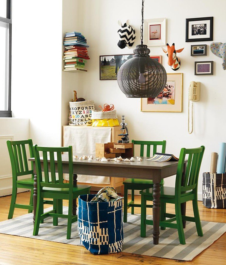 A dining room doubles as a play space with a table for crafts and boardgames